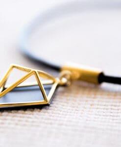 שרשרת ג'יאו מעויין קוסמי שחור זהב על עור